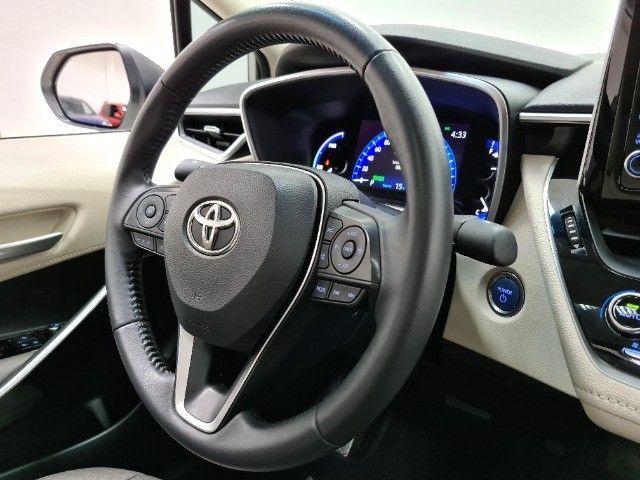 Corolla Altis Premium Hybrid 1.8 Flex Aut. | Apenas 10mil kms + Único dono! - Foto 7