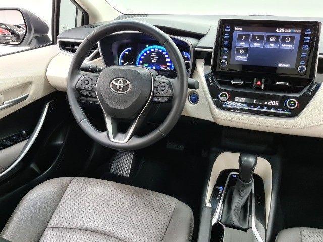 Corolla Altis Premium Hybrid 1.8 Flex Aut. | Apenas 10mil kms + Único dono! - Foto 10