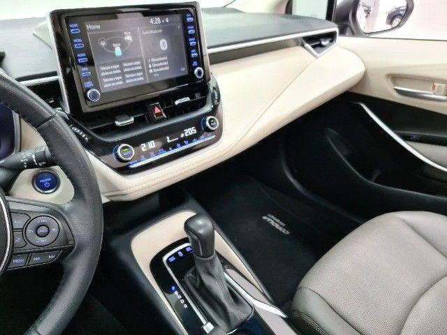 Corolla Altis Premium Hybrid 1.8 Flex Aut. | Apenas 10mil kms + Único dono! - Foto 6