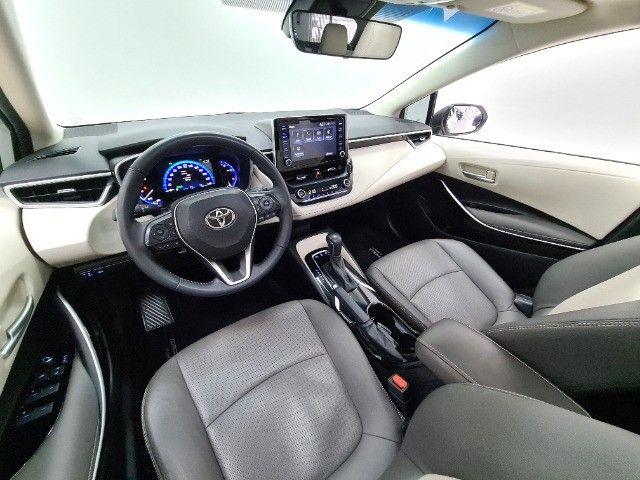 Corolla Altis Premium Hybrid 1.8 Flex Aut. | Apenas 10mil kms + Único dono! - Foto 18