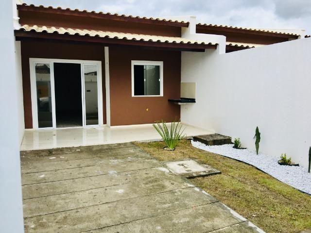 Documentação Inclusa: 2 quartos, 2 wcs, garagem, sala, coz americana, quintal, área serviç