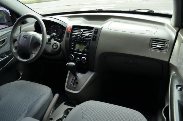 Hyundai Tucson 2.0 gl gasolina automática * completa * pneus novos - Foto 10