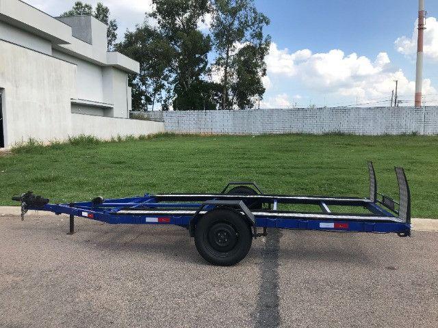 Carretinha reboque para veiculos Capacidade 1300 kg articulável, pneus novos - Foto 7
