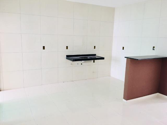 Documentação Inclusa: 2 quartos, 2 wcs, garagem, sala, coz americana, quintal, área serviç - Foto 6