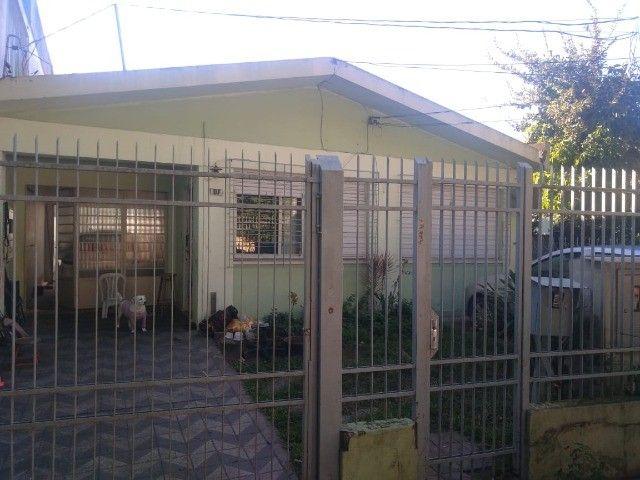Vendo ou troco casa no centro de Sta Maria (aceita apartamento)