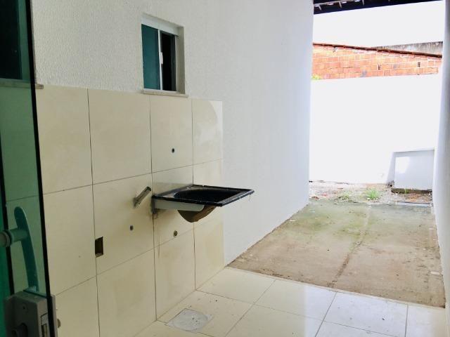 Documentação Inclusa: 2 quartos, 2 wcs, garagem, sala, coz americana, quintal, área serviç - Foto 12