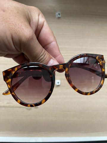 Oculos varios modelos onça de sol e etc