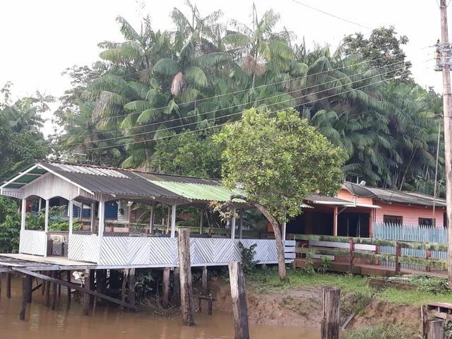 Vendo casa na beira do rio(96)99152-2056
