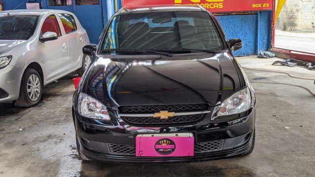 Corsa sedan premiun 1.4 completo + Gnv ( 2mil+ 48×460,00)  - Foto 3