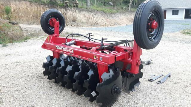 Grade aradora 14 X 26 para trator - Foto 5