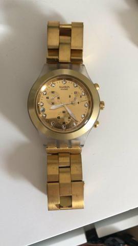 51a8a4c143d Relógio Swatch Full Blooded Dourado Original - Bijouterias