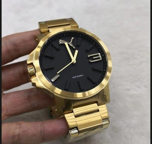 c5bf9bbbb71 Relógio puma dourado - Bijouterias