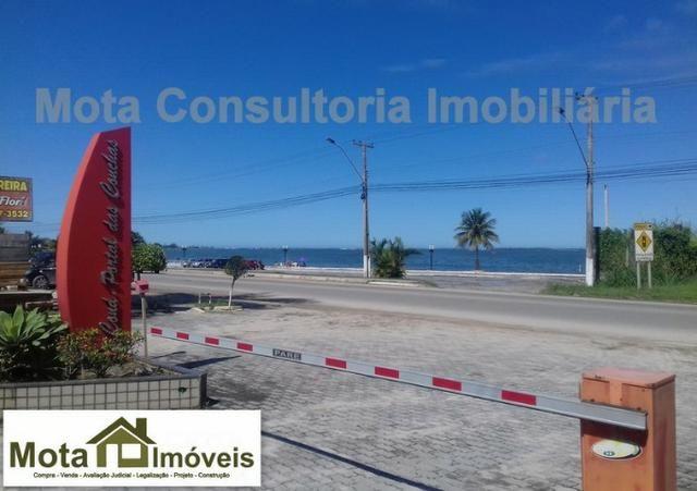 Mota Imóveis - Lindo Terreno 315m² Condomínio Alto Padrão - Praia do Barbudo - TE-112