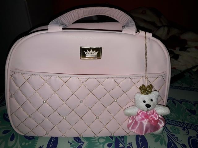 Uma bolsa nova de bb menina nova