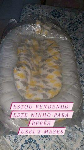 Vendo bebê canguru novo nunca usei,e esse ninho é seminovo unissex   - Foto 2