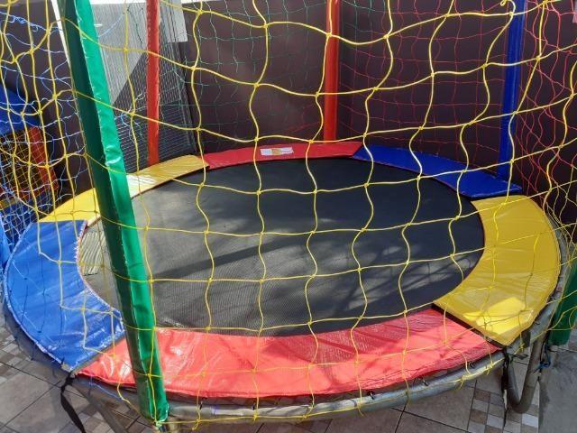 Aluguel de pula pula ,piscina de bolinhas,gangorra e castelinho com escorrega infantil - Foto 4