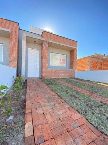 Casa nova com 2D e pátio (Financiável)