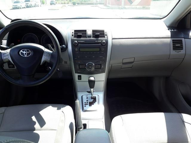 Toyota Corolla XEI automático, couro, completo, super novo - Foto 9