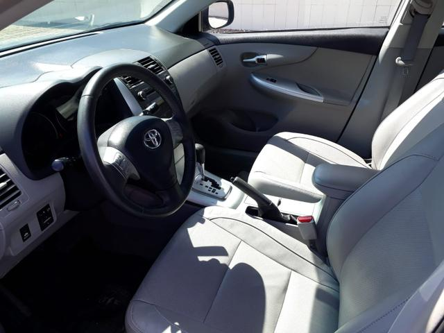 Toyota Corolla XEI automático, couro, completo, super novo - Foto 8