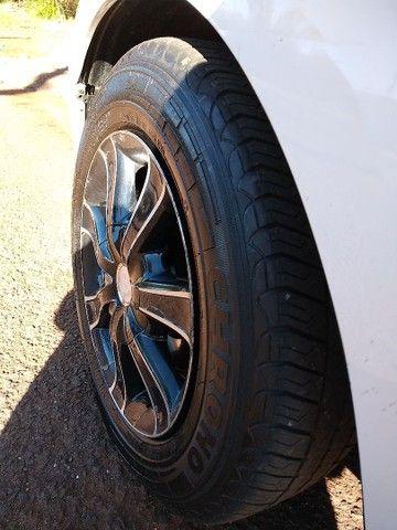 Rodas 14 pneus meia vida. - Foto 5