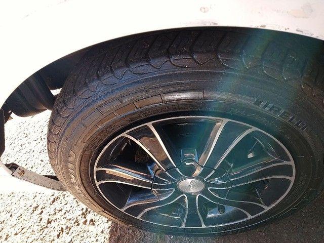 Rodas 14 pneus meia vida. - Foto 3
