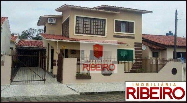 Casa com 4 dormitórios à venda, 180 m² por R$ 600.000,00 - Coloninha - Araranguá/SC
