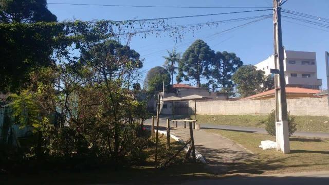 Terreno de esquina com casa de madeira - Foto 3
