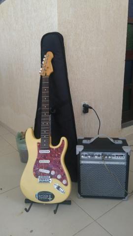 Guitarra + caixa amplificada
