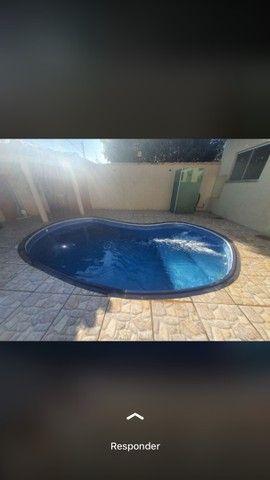 Casa 3 quartos sendo uma suíte, piscina aquecida