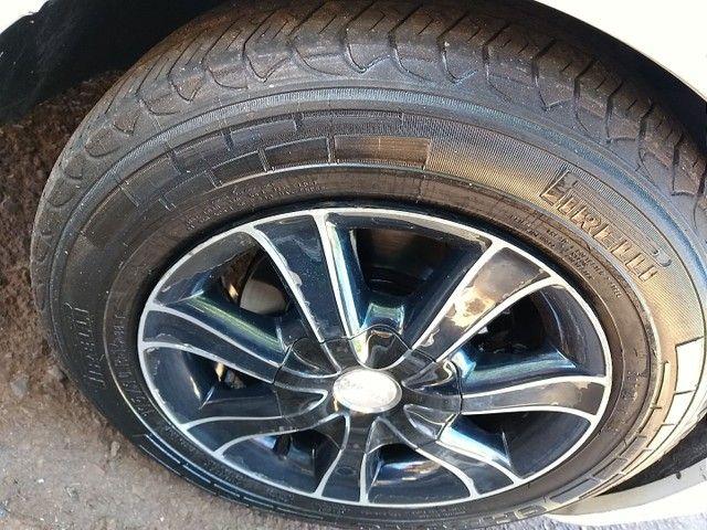 Rodas 14 pneus meia vida. - Foto 2