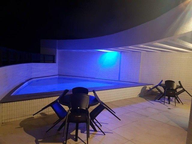 Alugo apt 2 qts mobiliado, andar alto varanda, lazer a 50 mts do mar - Foto 3