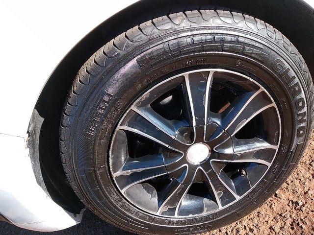 Rodas 14 pneus meia vida.