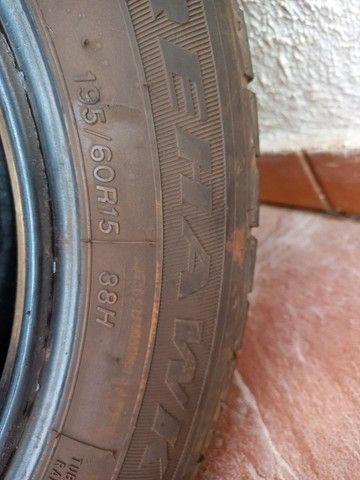 Vendo 2 pneus F 900 meia vida - Foto 2