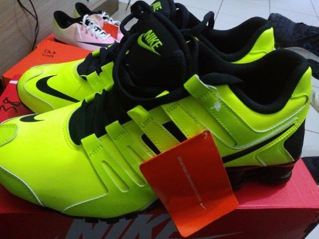 online store 8f34f b7296 Tênis Nike Shox Current Masculino Amarelo Fluorescente TM 38