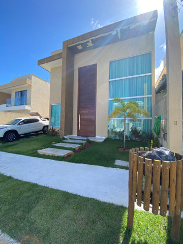 Linda casa em condomínio fechado 4/4 sendo 3 suítes - Foto 4