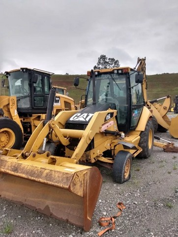 Retro Escavadeira Caterpillar 2014