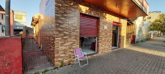 Sala comercial com casa de alvenaria ao fundos. Av. Borges de Medeiros, 960. - Foto 9
