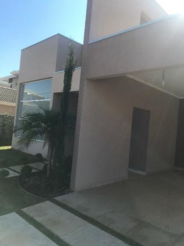 Aluguel de casa com piscina, condomínio fechado, área de lazer, lago e casa nunca habitada - Foto 6