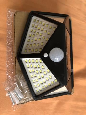 Lâmpada LED Fotocélula carregamento solar externa sem fio sensor acendimento automático - Foto 2