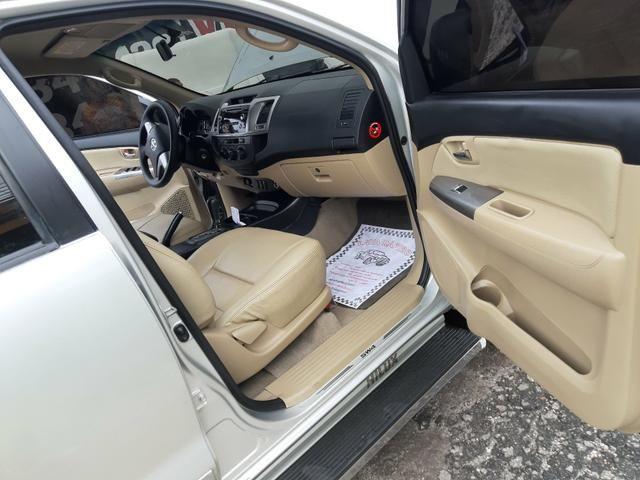 Toyota hilux sw4 sr top flex com gnv ano 2014 - Foto 13