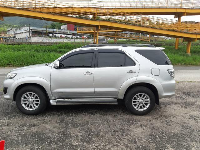 Toyota hilux sw4 sr top flex com gnv ano 2014 - Foto 5