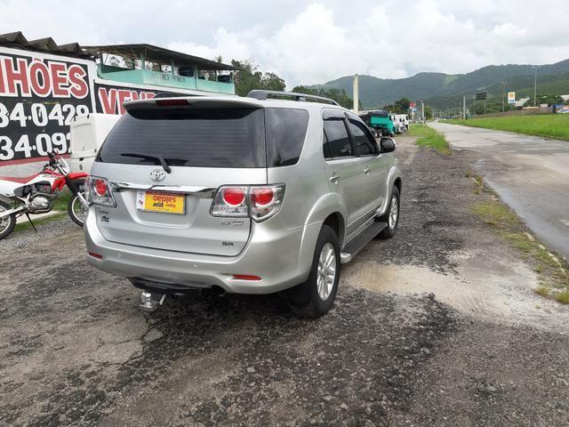 Toyota hilux sw4 sr top flex com gnv ano 2014 - Foto 7
