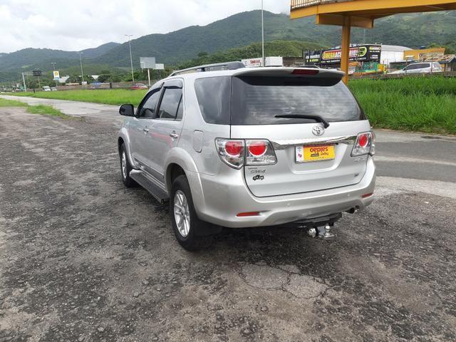 Toyota hilux sw4 sr top flex com gnv ano 2014 - Foto 6