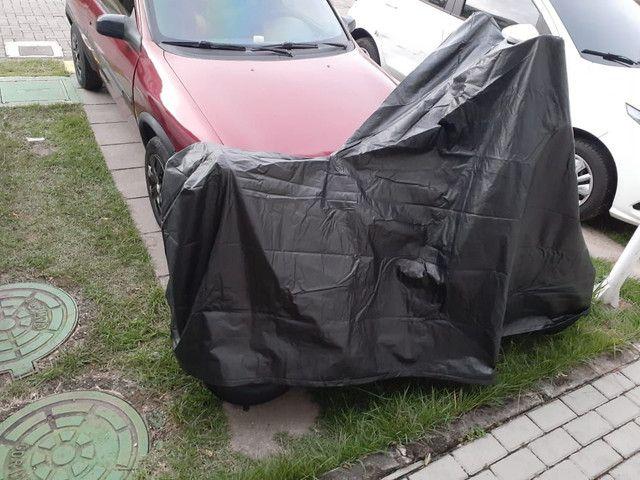 Capa de chuva para scooter elétrica  - Foto 11