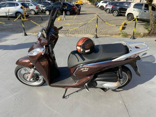 Honda SHI 300 Estado de Zero Pouco Rodada - Foto 5