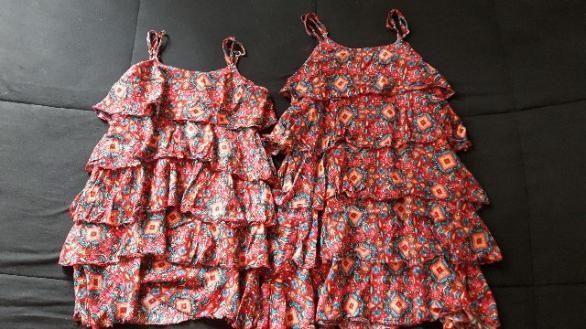Dois vestidos infantis em viscose, estampados, tam 6 e 8 anos. Ideal para irmãs