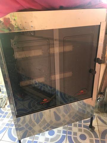 Vendo uma máquina de assar frango televisão de cachorro em perfeito estado - Foto 2