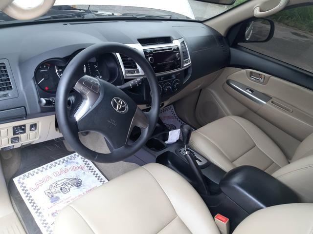 Toyota hilux sw4 sr top flex com gnv ano 2014 - Foto 12
