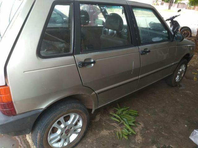 Carro Fiat uno Mille Fire 2002 número :