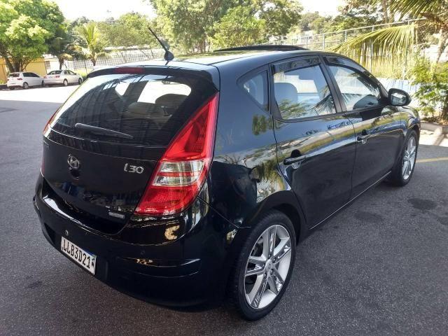 Hyundai i30 2010 automático top com teto - Foto 6
